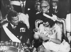 King Carl Gustaf and Queen Silvia with Princess Madeleine during baptism