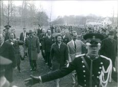 Carlos Hugo, Duke of Parma and Piacenza, and Princess Irene of the Netherlands walking among people. 1964.