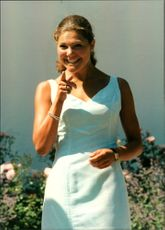 Crown Princess Victoria points to the camera during her 20th anniversary with the Solliden family.