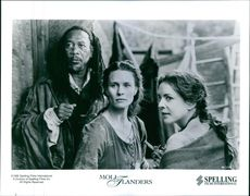 """1996 A scene of Hibble (FREEMAN, left), Moll (WRIGHT, center) and Mrs. Allworthy (CHANNING, right) are reunited in the marketplace weeks after Mrs. Allworthy is driven out of her house by righteous townspeople from the film """"Moll Flanders""""."""