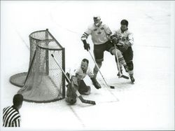Ice hockey player Sven Tumba down at the goal of the ice hockey match Sweden-CSSR during the Winter Olympics in Innsbruck in 1964