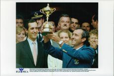 Portrait of the golfer Severiano Ballestero with a cup