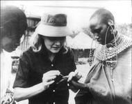 Carroll Baker with tribal woman.