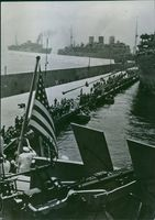 Axis prisoners line the dock to board the ship.