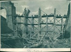 Soldiers standing at the wooden bridge during the first world war.