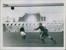 A photo of men playing football in a competition.