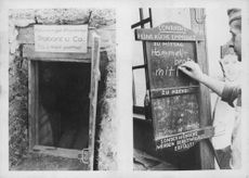 Small door entrance to a mine, and a man writing on a chalkboard. East front, Russia.  - 1942