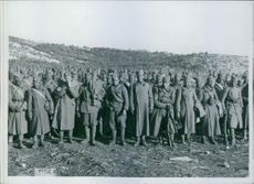 Soldiers standing together in the field during jugoslavia war.1941