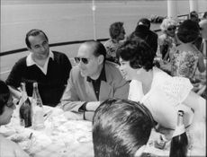 Roberto Rossellini, in conversation with his friends.