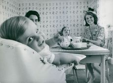Princess Margaretha with her husband John Ambler and their children happily eating together.