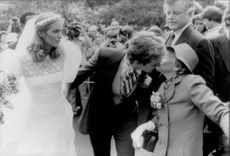 Peter McKelvy, newly married to Sydney Lawford, greets the bride's grandmother, Rose Kennedy.