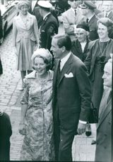 Beatrix and Claus of the Netherlands standing and smiling.