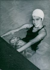 Photograph of Susan Tolton, at swimming pool.