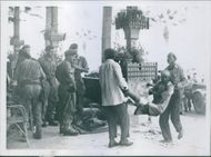 1956 Port Said Wounded Egyptian seen being carried to first aid post by some friends.
