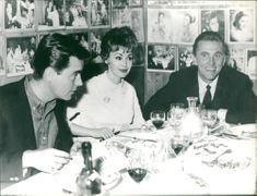 Kirk Douglas, Bob Wagner and Marion Donnen at a restaurant in Rome