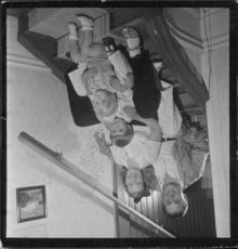 """Johan Jonatan """"Jussi"""" Björling on stairs sitting with his family."""