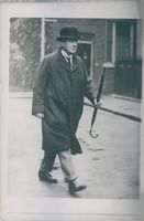 Prime Minister Stanley Baldwin on his way to office with his umbrella. 1937.