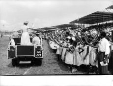 Princess Alexandra in the car, standing and waving to the people in Nigeria, 1960.