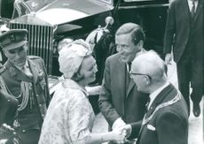 Beatrix and Claus of the Netherlands greeting man.