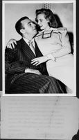 "June Allyson sitting on lap of Richard Ewing ""Dick"" Powell."