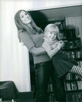 A Marika Nicolette Green playing with her daughter.