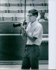 Jim Ryun came to watch and photograph one of his competitors, Kipchoge Keino who won the 5,000 meter race. 1967