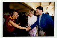 Sharon Stone and husband Phil Bronstein greet the Dalai Lama under garden party at Harrison Ford and Melissa Mathison