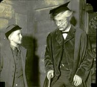 """Robert Donat in the movie """"Goodbye, Mr. Chips"""". Here he plays the old Mr. Chips with a small student."""