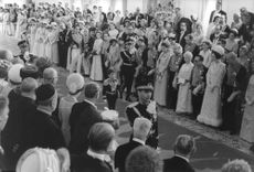 People watch as a Reza Pahlavi march the aisle.