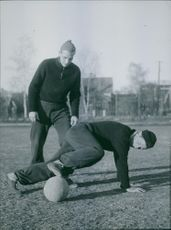 Footballer playing and getting trained on the ground. 1944
