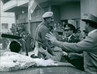 General Grivas embraced by man.   1959