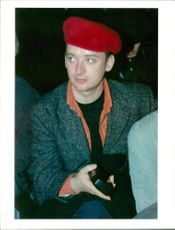 Boy George in his signature look wearing beret hat