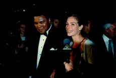 Portrait image of Muhammad Ali and Julia Roberts taken in conjunction with a charity dinner with Amnesty International.