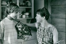 Jonathan Taylor Thomas and Frances Fisher in a movie scene.
