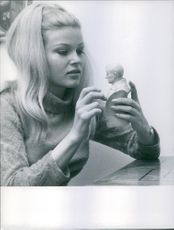 Close up of  Czech-American actress Olinka Bérová, while she is watching a sculpture