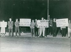 People carrying banner and demonstrating, 1966.
