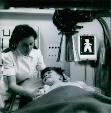 Nurse caring the child patient in the hospital.
