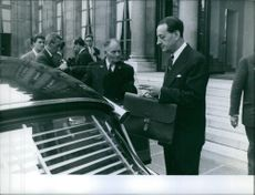 André Malraux getting inside the car. 1959.
