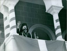 A photo of Makarios III standing to make a speech to the crowd.