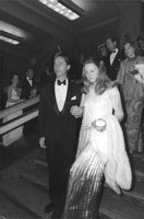Duke Carlos Hugo with wife Princess Irene of Netherlands walking down the stairs at a party.