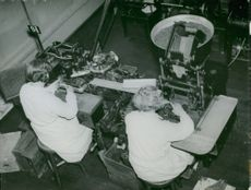 Two ladies at a cigarette rolling machine Tobacco monopoly factory