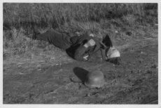 A dead soldier lying on the ground during war in Finland.  - Oct 1944