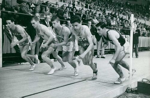 Michel Jazy and other athletes running for a race., 1962.