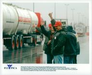 Truck drivers show thumbs up for colleagues driving away after the strike