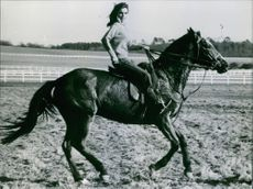 Danielle Gaubert, French actress, pictured riding a horse. 1967.