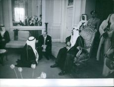King Saud sitting and talking with other people in Baghdad.
