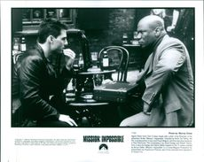 Tom Cruise meets with Ving Rhames in the adventure thriller Mission: Impossible.