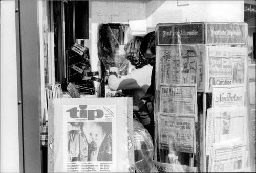 A newspaper stand at a kiosk