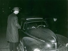 Gaston Naessens getting in the car. 1964.