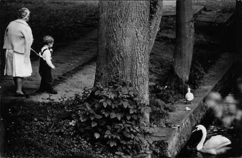 Audrey Hepburn's Son having a walk in a park with a nanny.